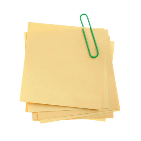clinch: Paper note with green clinch. It is attached red pin on a white background