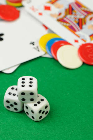 dices and playing cards. Game cubes and Playing cards on a green background