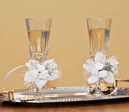 Wedding glasses. Glasses with a champagne decorated decorative flower photo