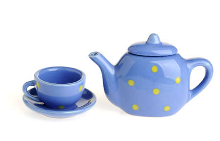 cups and teapot. Tiny utensils it is isolated on a white background photo