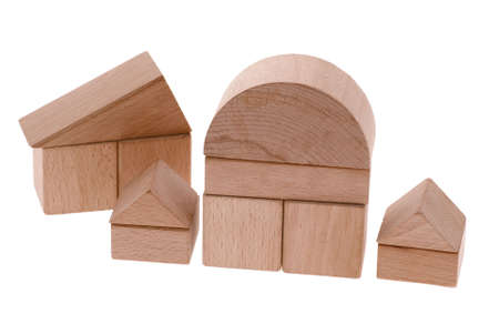 Toy houses. Wooden cubes combined in the form of constructions Stock Photo - 4928529
