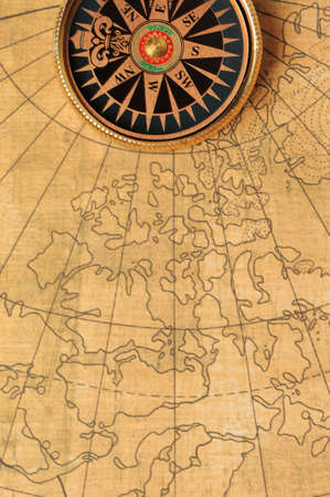 Old compass and map background. Old gold color Stock Photo