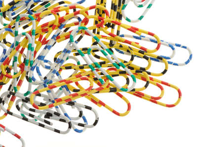 Color paper clips. Office subject it is isolated on a white background photo