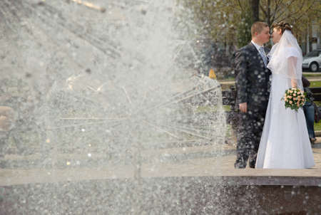Newly-married couple. Pair young men in wedding day photo