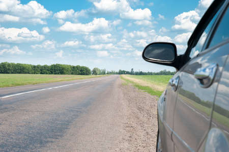 cornering: The car and road. A fragment of the car and a line Stock Photo