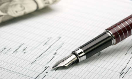 Business a theme. Diagrams from the share market, pens. Concept - exchange activity Stock Photo - 5135096