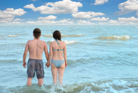 Pair on seacoast. The enamoured guy and the girl walking on coast Stock Photo - 5162710