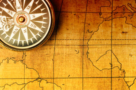Old compass and map background. Old gold color photo