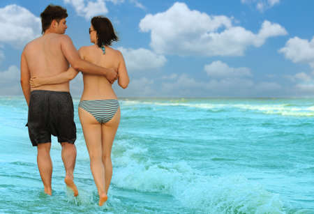 Pair on seacoast. The enamoured guy and the girl walking on coast Stock Photo - 5225781