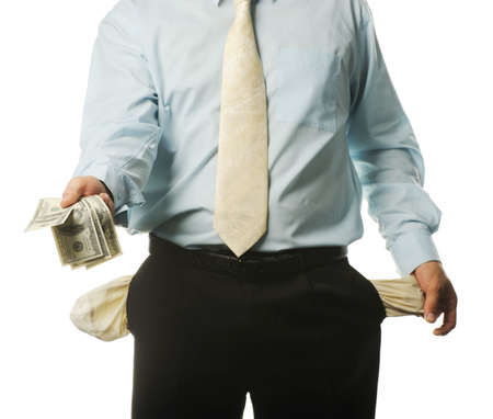 moneyless: The young businessman with empty pockets. It is isolated on a white background