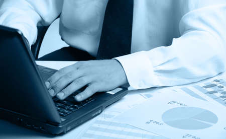 Hands of the businessman above the keyboard laptop. Blue color Stock Photo - 5260161