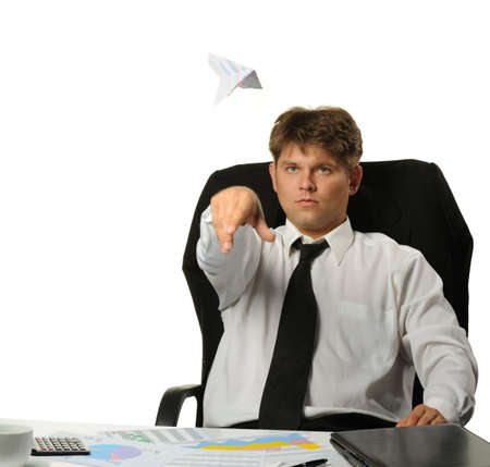 The businessman the starting paper plane. It is isolated on a white background photo