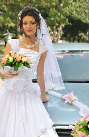 The beautiful bride. The young girl in a wedding dress. photo