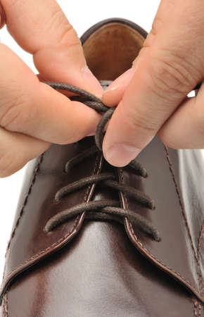 fasten: To fasten bootlace on shoes. A photo close up