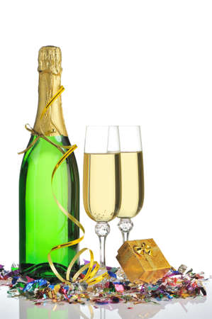 Bottle of a champagne and glasses. A celebratory tinsel and a box with a gift Stock Photo