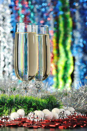 Glasses of a champagne. A christmas drink on the dim color background Stock Photo - 5596111