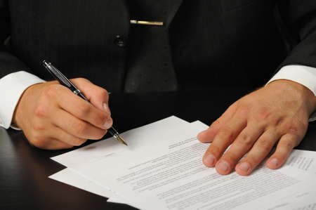 The businessman the signing contract. Hand closeup. photo