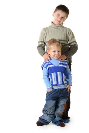 Two brothers. Age of 3 and 7 years. It is isolated on a white background photo