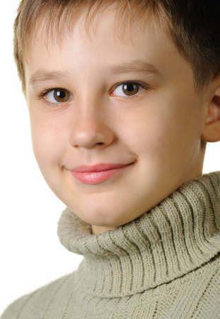 Portrait of the boy. Age of 7 years. It is isolated on a white background photo