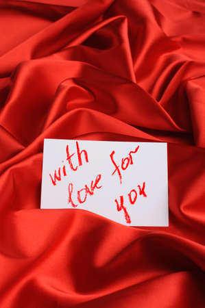 Note on red silk. With an inscription  With love for you . Drawn by lipstick photo