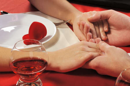 loving couple: Romantic supper. A close up. Young the man does the offer to the girl. Stock Photo