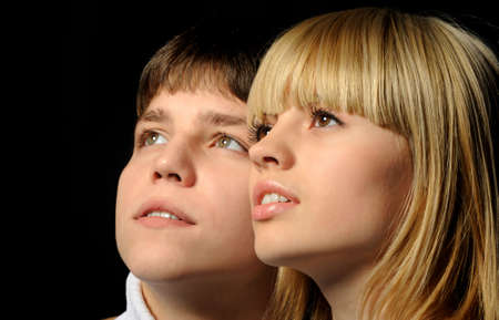 Young enamoured pair. A romantic atmosphere. A dark back Stock Photo - 6135988