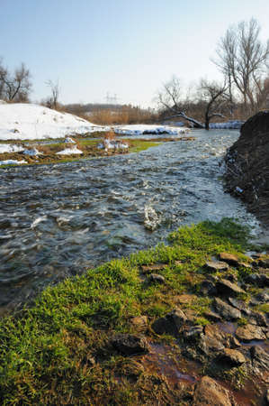 thawing: The spring river. A rough stream after a spring thawing weather