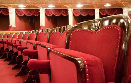 Theatrical armchairs. An interior of opera theatre. Odessa, Ukraine photo