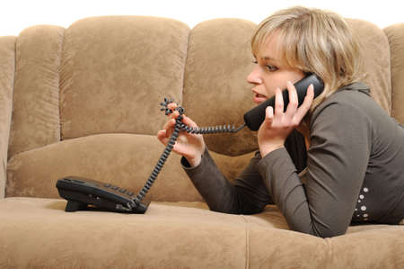 The woman speaking by phone on a sofa.House conditions photo