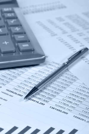 The calculator and the financial report. A workplace of the businessman photo