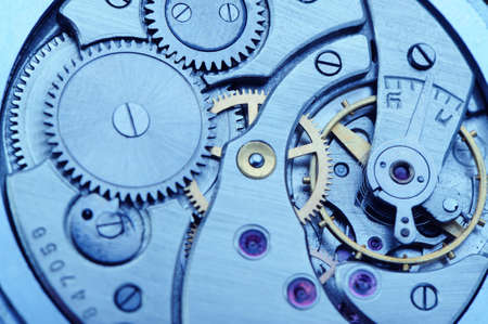 The mechanism of analog hours - blue tone. A photo close up photo