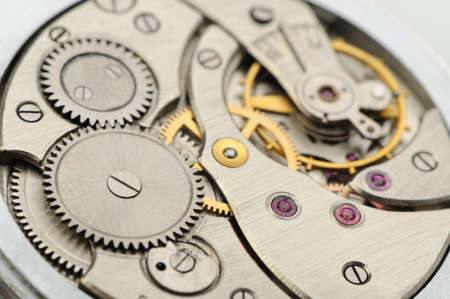 The mechanism of analog hours. A photo close up photo