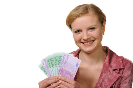 The young woman holds the European currency in hands. It is isolated on a white background photo