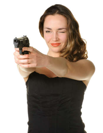 The woman with a pistol. It is isolated on a white background photo