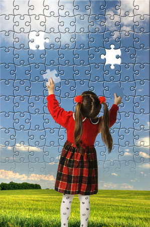 games hand: The girl assemble big puzzle. Landscape on a picture