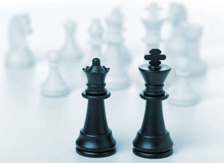 Chess king and queen. Black figures, concept of dialogue photo