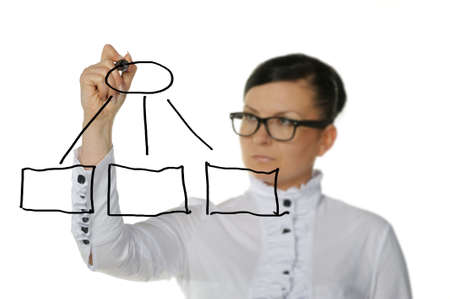 The woman drawing the diagram. Selective focus. It is isolated on a white background. photo