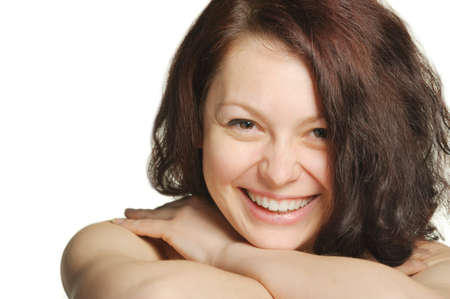 The laughing young woman, head on hands. Natural beauty. It is isolated on a white background photo