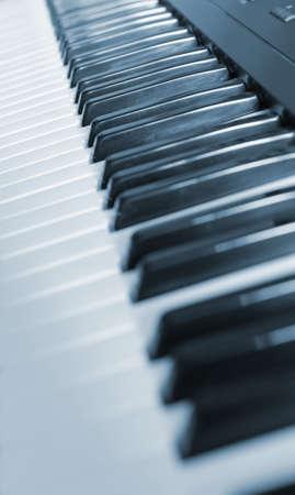 Keys of the piano. A photo close up. Blue tone. photo