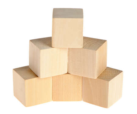 yellow block: construction from wooden cubes. It is isolated on a white background Stock Photo