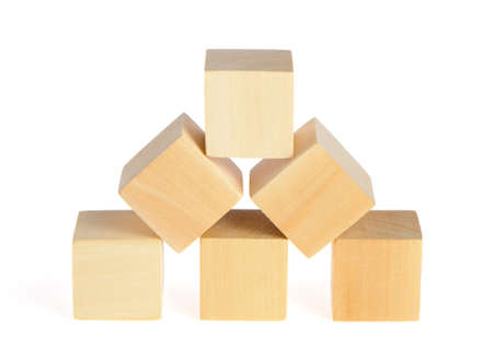 construction from wooden cubes. It is isolated on a white background Stock Photo - 7149133