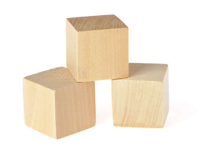 construction from wooden cubes. It is isolated on a white background photo
