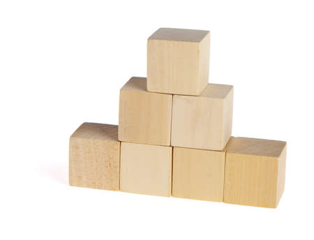construction from wooden cubes. It is isolated on a white background Stock Photo - 7337140