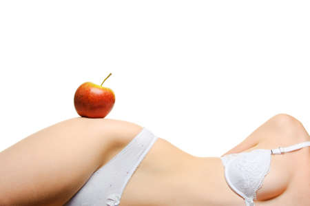 nude young: Female shapely a body and a red apple. It is isolated on a white background Фото со стока