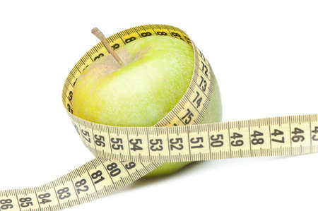 Closeup of green apple with a measuring tape. Isolated on white Stock Photo - 7402282