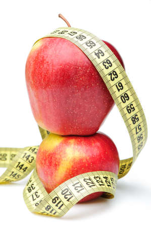 Closeup of a red apple with a measuring tape. Isolated on white Stock Photo - 7402286