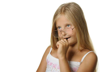 cogitate: The thoughtful girl the blonde in glasses and with pen. It is isolated on a white background