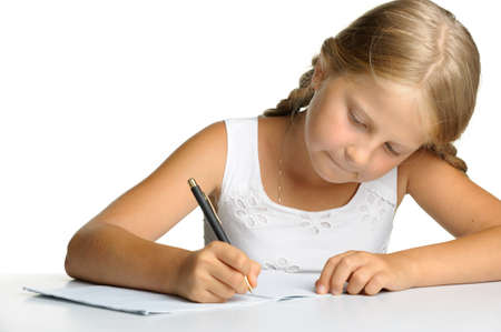 The girl writes to writing-books. The decision of lessons. It\ is isolated on a white background