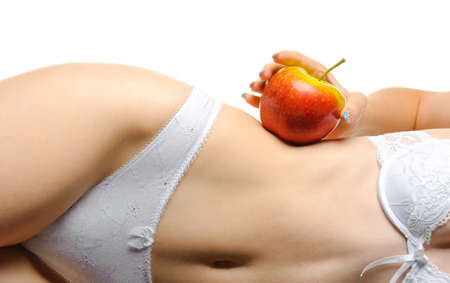 Female shapely a body and a red apple. It is isolated on a white background Stock Photo - 7628338