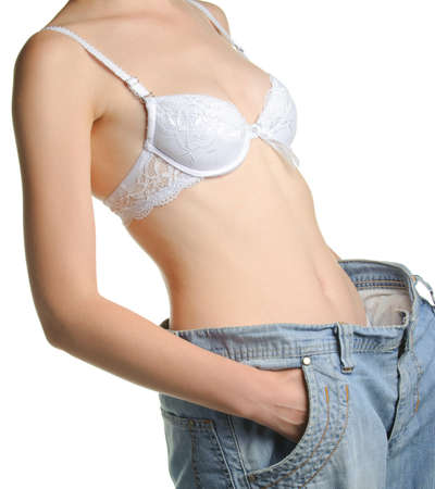 Women and jeans of the greater size. The concept of growing thin. It is isolated on a white background Stock Photo - 7806756
